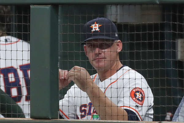 Houston Astros manager A. J. Hinch watches the game from dugout during the 1st-inning of an MLB baseball game at Minute Maid Park Tuesday, May 28, 2019, in Houston.