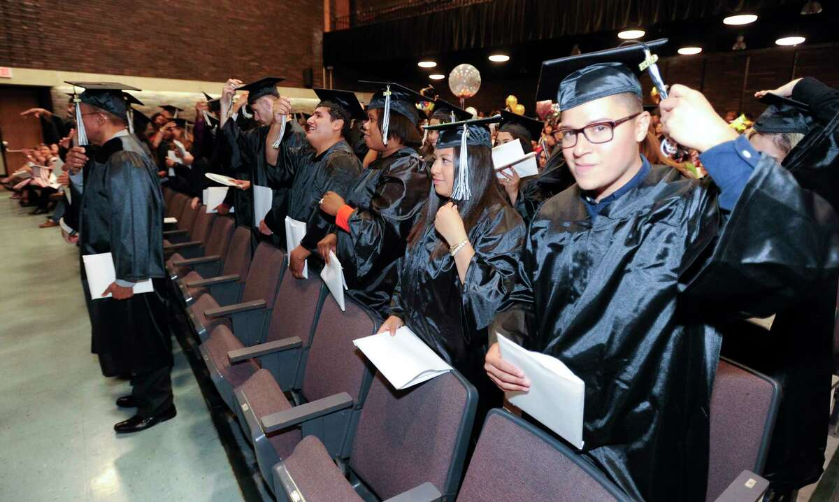 Graduate Horlan Aguilar, at right, moves his tassel, signifying that he has graduated at the conclusion of the Stamford Public Schools Adult and Continuing Education Class of 2019 Graduation ceremony at Cloonan Middle School on May 29, 2019 in Stamford, Connecticut.