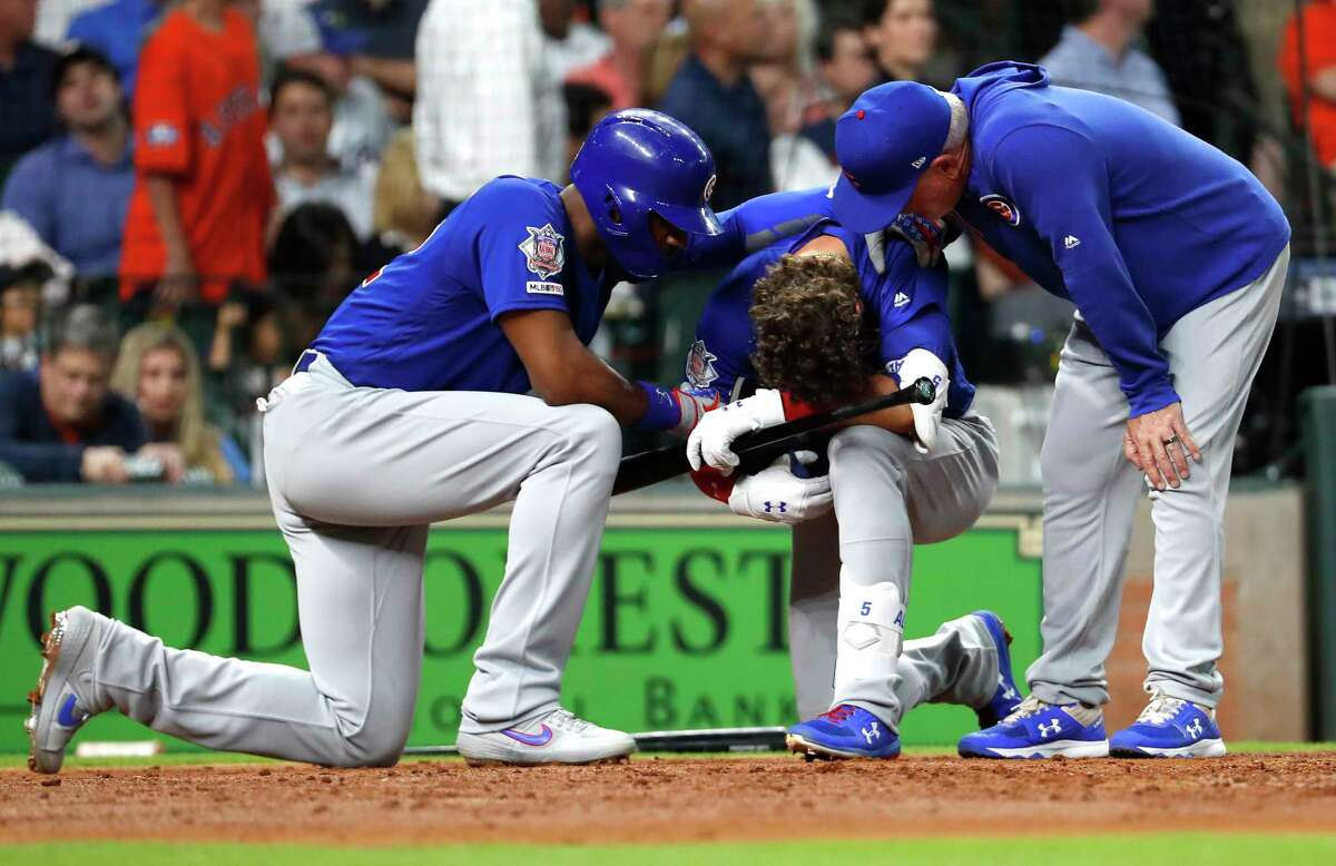 Chicago Cubs center fielder Albert Almora Jr., center, reacts after a foul ball he hit into the stands hit a small child during the fourth inning of a major league baseball game against the Houston Astros at Minute Maid Park on Wednesday, May 29, 2019, in Houston.