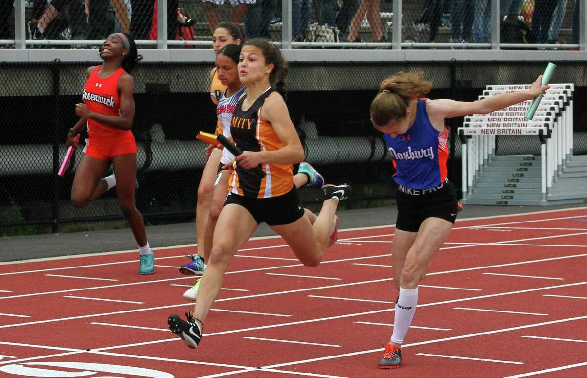 Amity's Audrey Marin crosses the finish in the girls 4X100 relay final during Class LL Track and Field Championship action in New Britain, Conn., on Wednesday May 29, 2019.