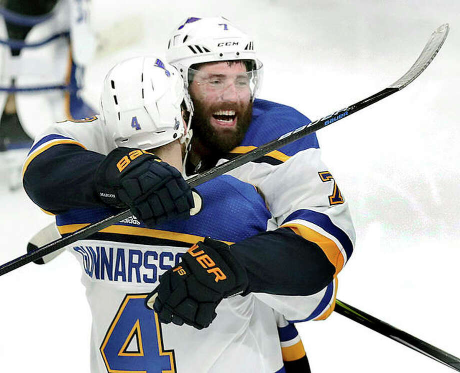 The Blues' Carl Gunnarsson (4) is congratulated by Pat Maroon after Gunnarsson scored the winning goal against the Boston Bruins in overtime in Game 2 of the Stanley Cup Finals Wednesday in Boston. Photo: AP Photo
