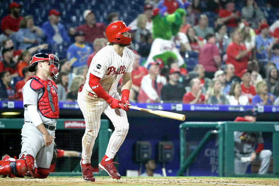 The Phillies' Bryce Harper follows the flight of the ball after hitting a home run against the Cardinals Wednesday night in Philadelphia.