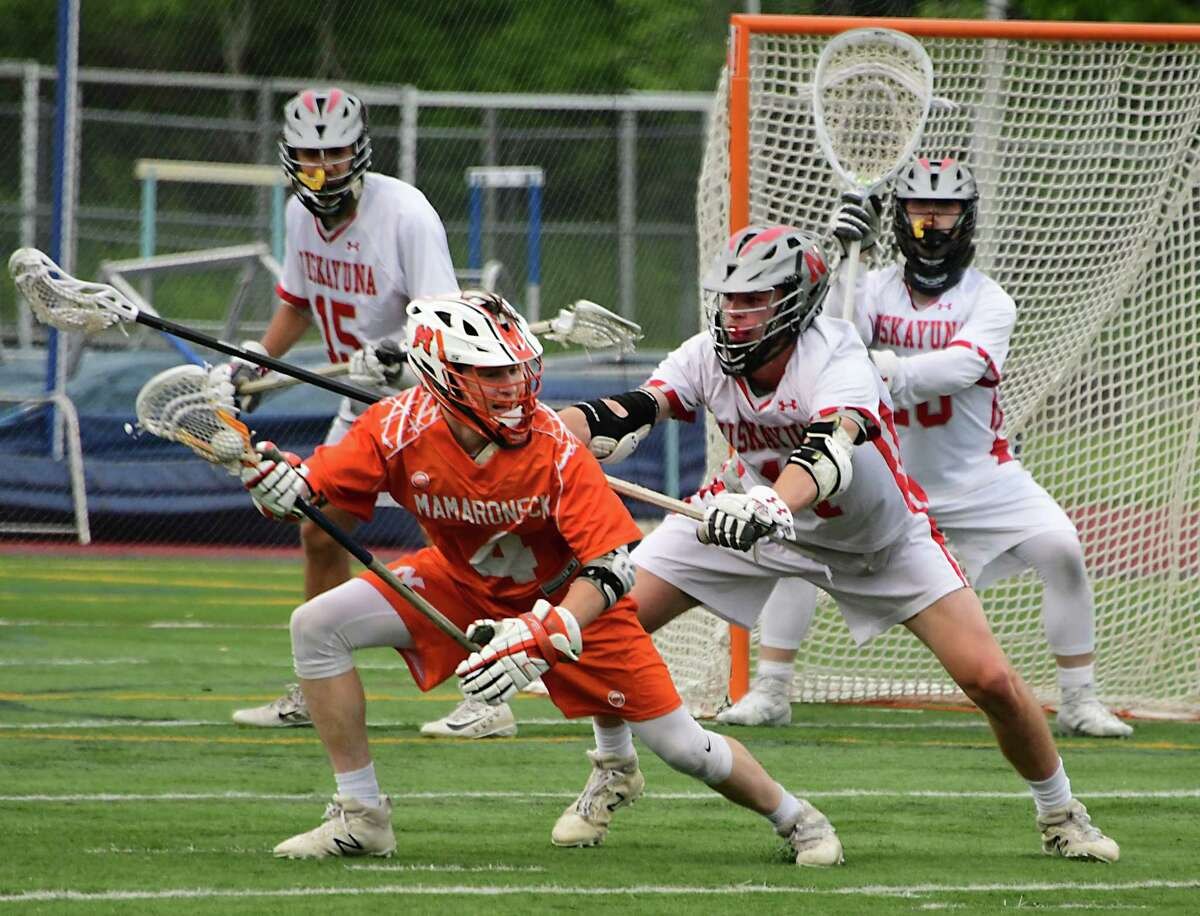 Niskayuna's Nick Fraterrigo doesn't let Mamaroneck's Thomas Conley near the net during the Class A boys' state regional lacrosse game held at Columbia High School on Wednesday, May 29, 2019 in East Greenbush, N.Y. (Lori Van Buren/Times Union8
