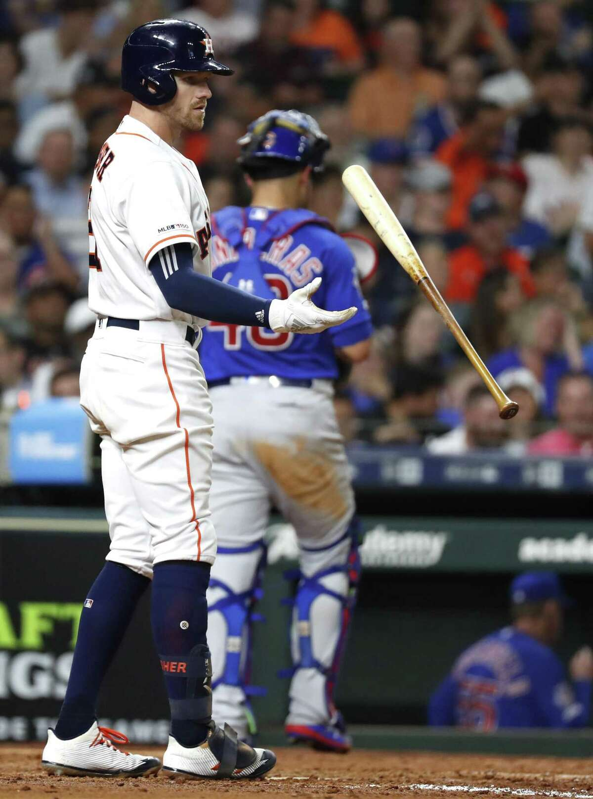 The Astros' Derek Fisher flips his bat after striking out. He fanned three times in the game.
