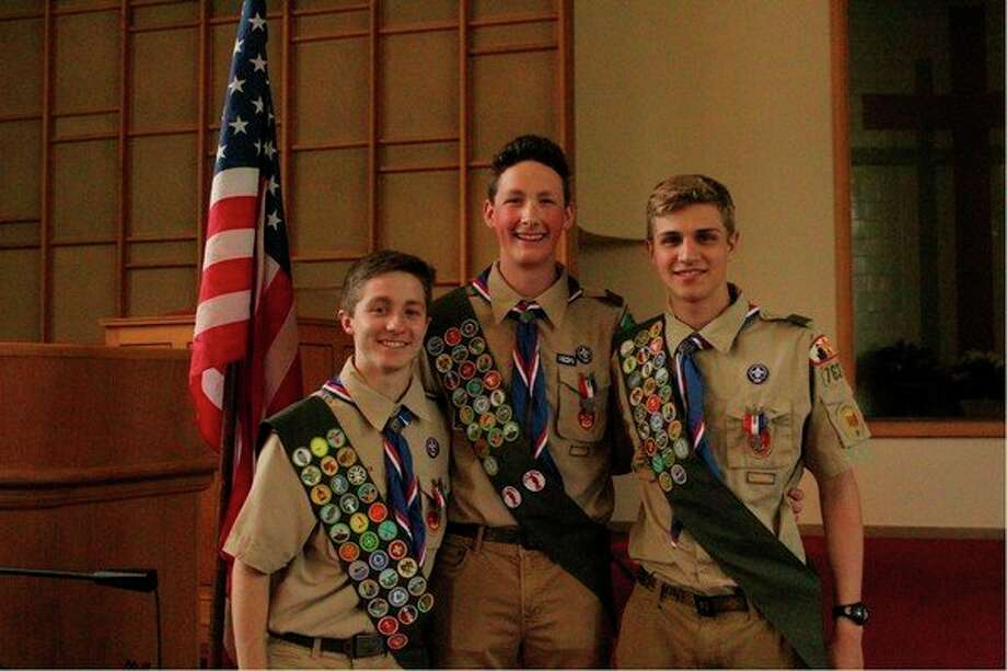 On Saturday, May 18, three Boy Scouts from Troop 763, First Baptist Church, celebrated achieving the rank of Eagle Scout. All three scouts attend H.H. Dow High School. From left: senior Max Morey, junior Austin Urlaub and senior Jacob Telgenhoff. The boys each completed an Eagle Scout project around the community. Max Morey built a Hammock Village in Emerson Park. Austin Urlaub constructed a Gaga Ball Pit for Blessed Sacrament Church & School. Jacob Telgenhoff worked at preventing the spread of erosion behind Shelterhouse.
