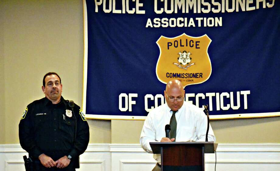 The Police Commissioners Association of Connecticut offered Meritorious Service awards to a number of officers Wednesday, including Detective Michael Harton of the North Haven police. Here, Officer Mark LeCardo of the Stratford Police Department. Photo: CONTRIBUTED PHOTO /