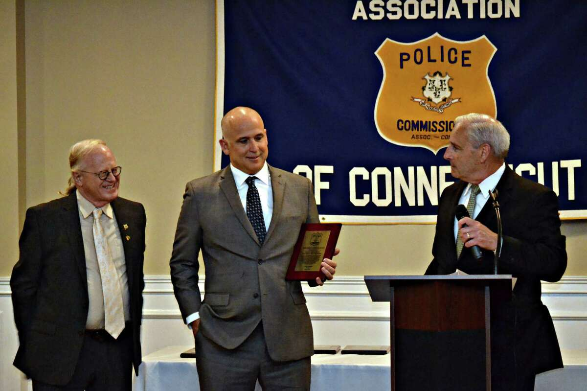 The Police Commissioners Association of Connecticut offered Meritorious Service awards to a number of officers Wednesday, including Detective Michael Harton of the North Haven police. Here, Harton is pictured with North Haven Police Commissioner Alden Mead (left) and North Haven Police Chief Thomas J. McLoughlin.