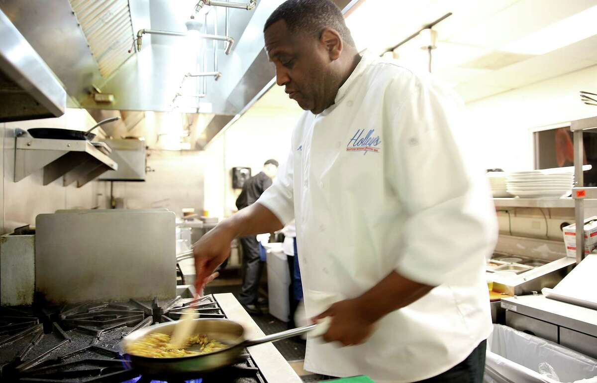Chef Mark Holley of Holley's Seafood Restaurant & Oyster Bar cooks up succotash featuring corn, cured pork shoulder and runner beans.