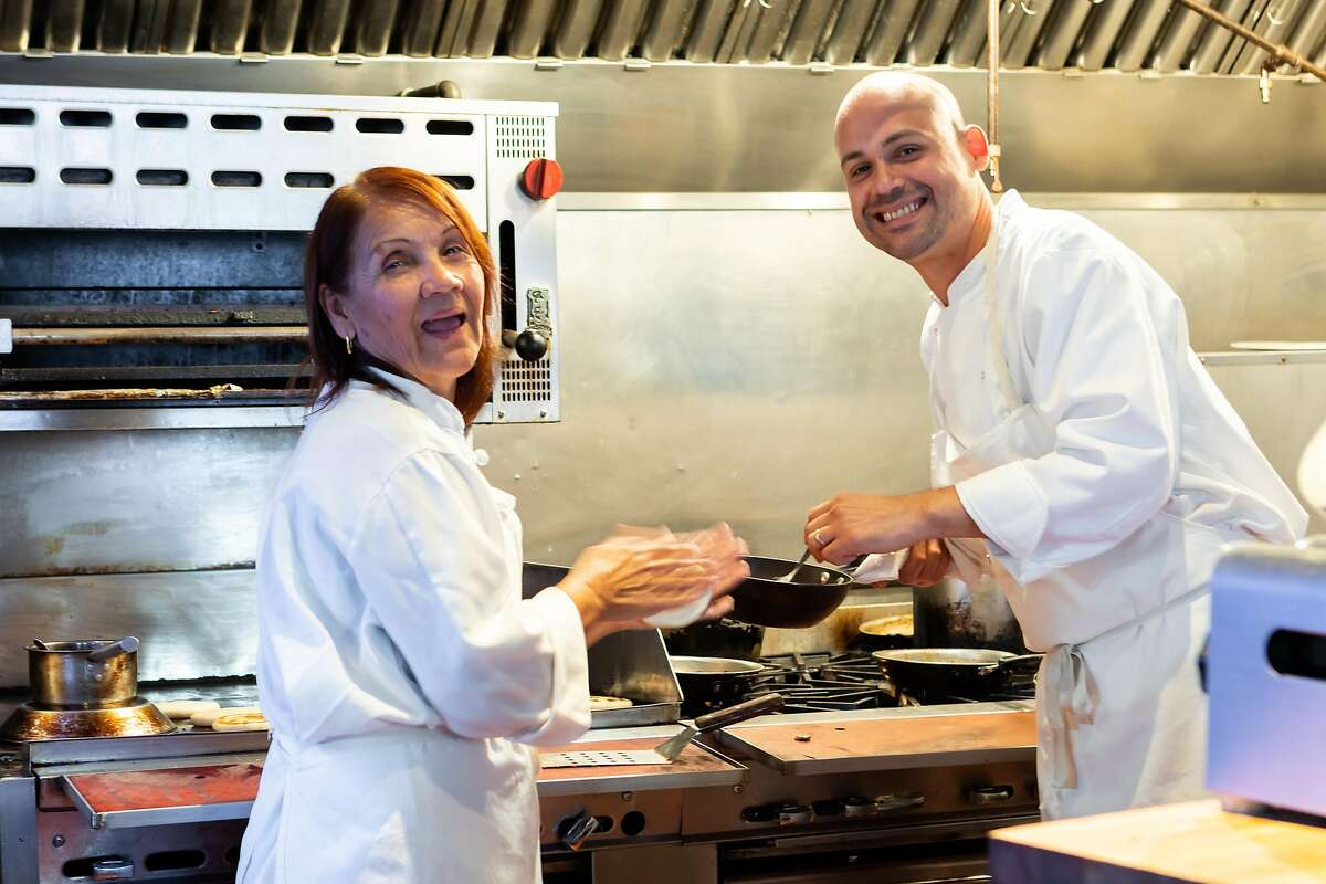 Chef Manny Torres Gimenez cooking with his mother, Gaudy de Torres, at Francisca's in 2019. The restaurant has closed.