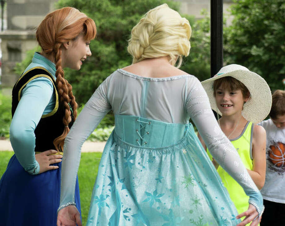 """Keegan Shultz talks to Elsa and Anna from """"Frozen"""" about her plans for the summer. The princesses were greeted by a line of fans waiting to meet them. Photo: Breanna Booker 