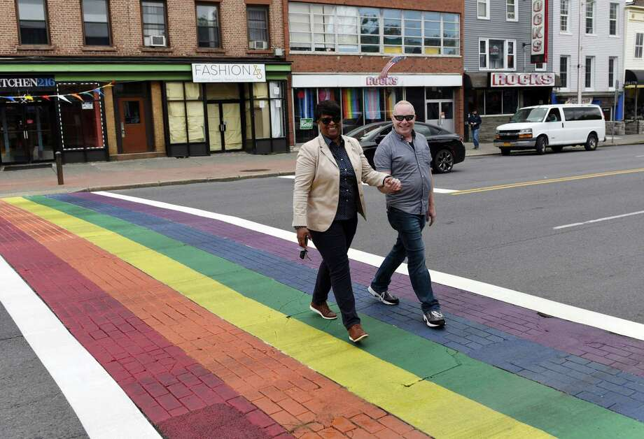 Executive Director of In Our Own Voices Tandra LaGrone and Water Works Pub General Manager Scott Levine smile for a picture as they walk across the Central Avenue crosswalk that was painted in recognition of Pride Month on Thursday, May 30, 2019 in Albany, NY. (Phoebe Sheehan/Times Union) Photo: Phoebe Sheehan, Albany Times Union / 40047082A