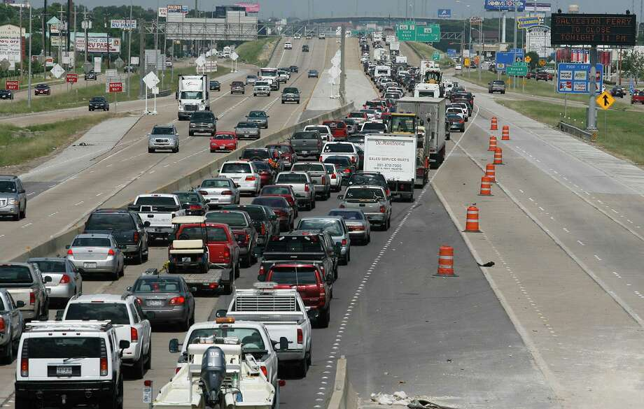 "Completion of work to expand Interstate 45 in the League City area will be the biggest factor affecting mobility projects in the city, City Manager John Baumgartner says. ""I-45 is the heartbeat, the main artery, for the whole community,"" he said. The interstate is also key hurricane evacuation route, as shown in this photo of northbound traffic on the highway in League City in 2008 as residents fled the path of Hurricane Ike. Photo: Kevin M. Cox, MBR / ASSOCIATED PRESS / AP2008"