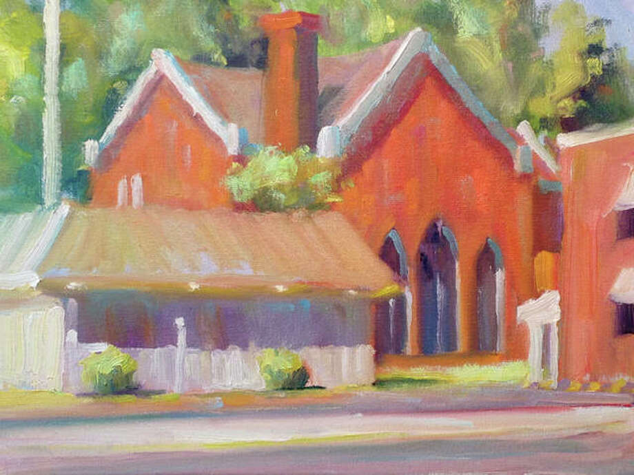 A painting of First Christian Church by John DenHouter is just one of many paintings on display featuring landscapes, buildings and landmarks in Edwardsville. The exhibit is in celebration of Edwardsville's 200th Anniversary this year. Photo: For The Intelligencer