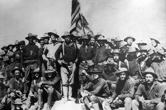 Col. Theodore Roosevelt and the 1st United States Volunteers Cavalry on top of San Juan Hill Cuba 1898. Copy photo