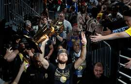 Stephen Curry (30) walks off the arena floor with the Larry O'Brien Trophy after the Golden State Warriors defeated the Cleveland Cavaliers in Game 4 of the 2018 NBA Finals. What does it mean to be a Warriors fan at a time of unprecedented team dominance and unprecedented local dissatisfaction?
