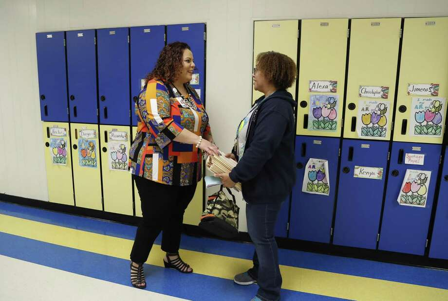 "MacArthur Elementary School principal Maria Munoz, left, talks with 2nd grade teacher, Kimone Singleton, during Career Day at MacArthur Elementary, a Gold Ribbon campus in Galena Park ISD, Thursday, May 23, 2019. Munoz attended MacArthur as a student, and represents part of the ""homegrown"" program that brings back former students. Photo: Karen Warren,  Houston Chronicle / Staff Photographer / © 2019 Houston Chronicle"