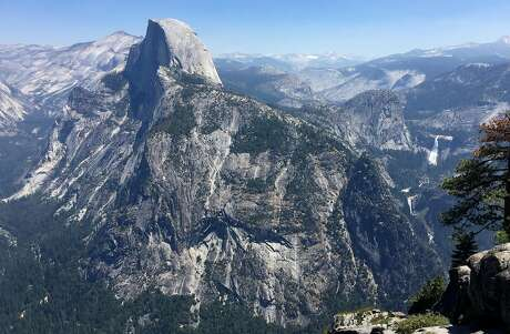 View of Half Dome from Glacier Point inside Yosemite National Park Thursday, July 20, 2017. The air quality inside the park has been affected by the Detailer fire burning just west of the park. Pollution is a 'significant' problem at 401 national parks, a recent report says. (Brian van der Brug / Los Angeles Times/TNS)
