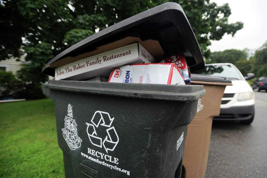 A full recycling bin sits on Cady Street in Stamford. Photo: Michael Cummo / Hearst Connecticut Media / Stamford Advocate