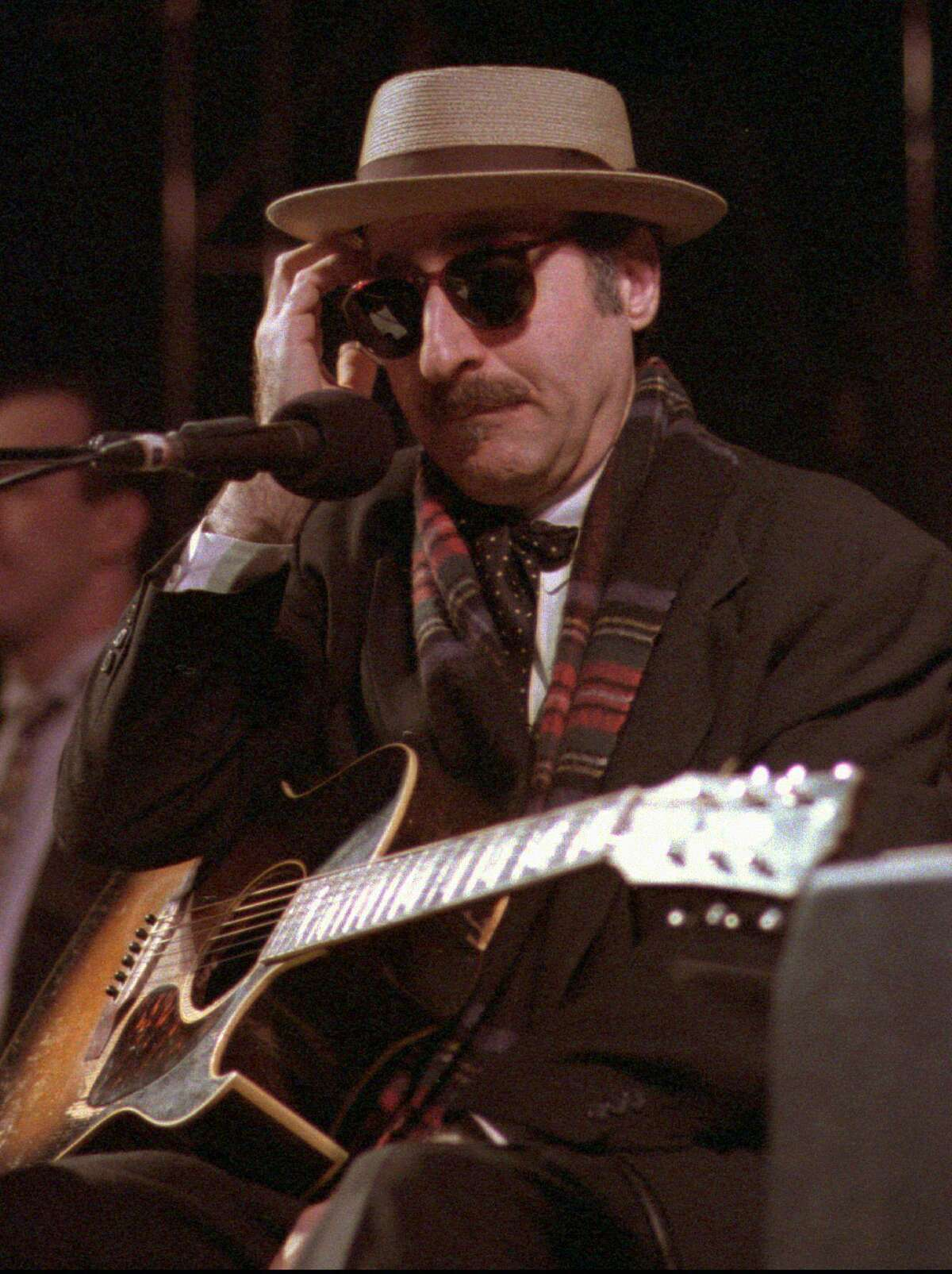 The unclassifiable Leon Redbone performs at the eighth annual Redwood Coast Dixieland Jazz Festival in Eureka, Calif., Saturday, March 28, 1998. The Redbone repertoire mixes old-time blues, jazz and vaudeville tunes. (AP Photo/Times-Standard, Patricia Wilson) Ran on: 08-10-2007 Leon Redbone says he never knows what songs hell play. He picks them on the spot.