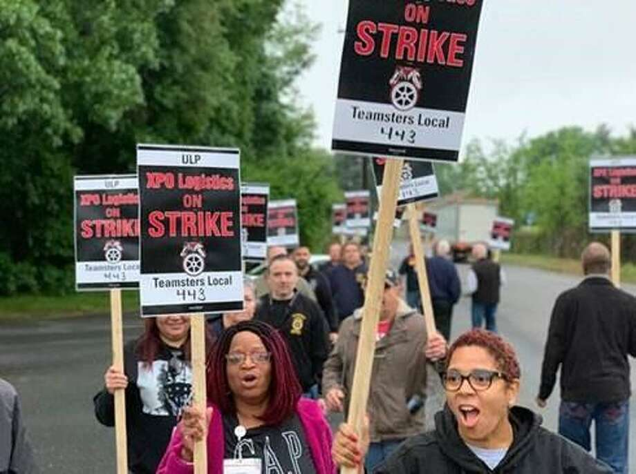 About a dozen workers at an XPO Logistics facility in North Haven, Conn., walked out the morning of Thursday, May 30, 2019, to protest allegedly unfair labor practices. Photo: International Brotherhood Of Teamsters