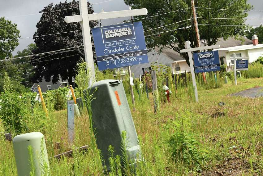 Empty lots at Maxwell Village on Wednesday, Aug. 1, 2018 in Colonie N.Y. The housing development off Maxwell road currently has occupied homes, completed homes for sale, homes under construction and lots to be built on. (Lori Van Buren/Times Union)