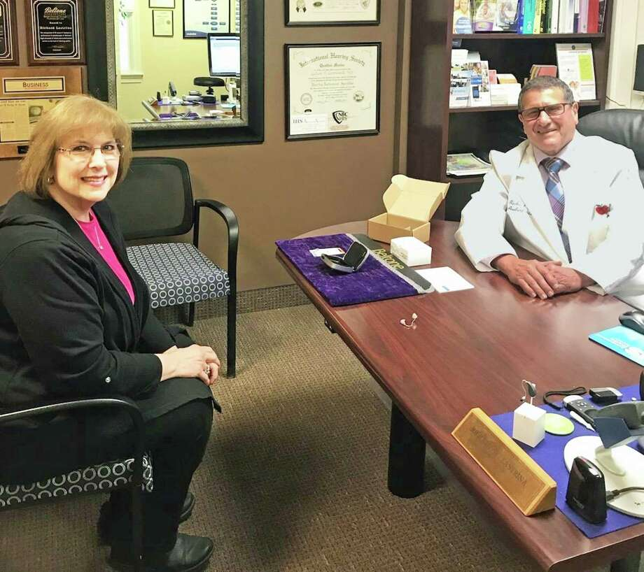 Loreen Barone was fit with her new hearing aids last week at The Beltone Hearing Center, 769 Newfield St., Middletown. She's shown with Hearing Instrument Specialist Richard Lastrina. Photo: Contributed Photo