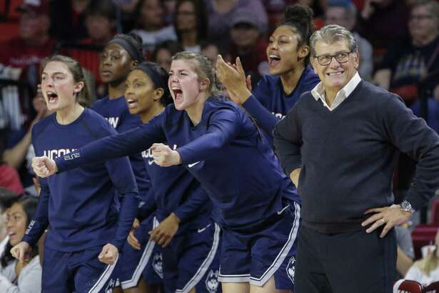 The UConn bench celebrates a play against Oklahoma during the second half of a game in Norman, Okla. on Wednesday, Dec. 19, 2018. UConn won 72-63.