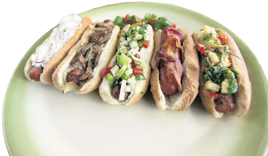 Gourmet-style hot dogs similar to these are part of the mission of Dog Haus, a California chain that's filed a permit for construction on a San Antonio location. Photo: Staff File Photo / Detroit Free Press
