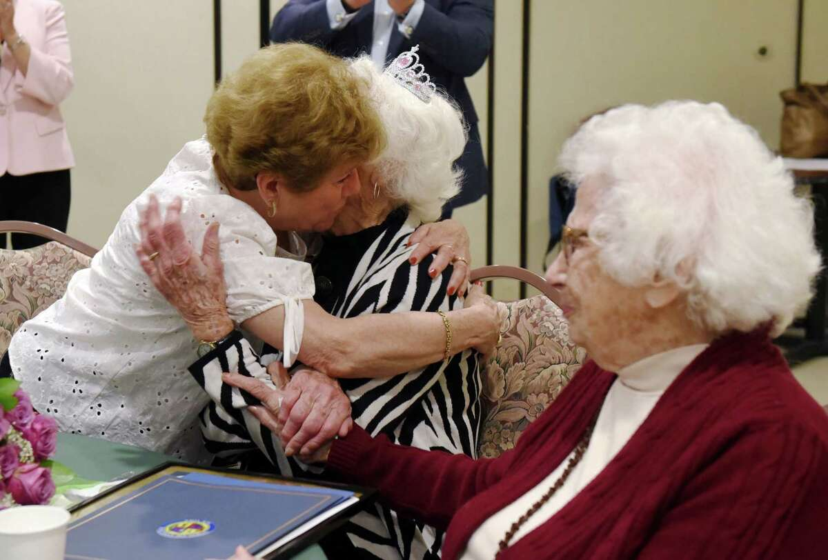 Janet Covais hugs her daughter, Janet Clemons, during Janet's 100th birthday celebration on Thursday, May 30, 2019 at the Beltrone Living Center in Colonie, NY. (Phoebe Sheehan/Times Union)