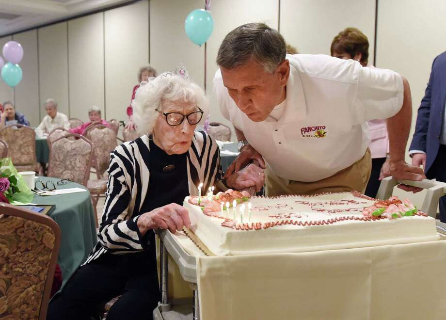 Janet Covais And Her Nephew Ron Blow Out The Candles On Janets Birthday Cake During