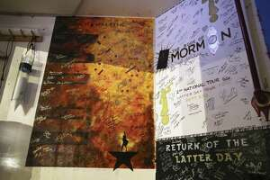 "As all touring shows do, the cast of ""Hamilton"" left behind a mural backstage at the Majestic Theatre. It can be found just off stage left next to murals by the casts of two productions of ""The Book of Mormon."""