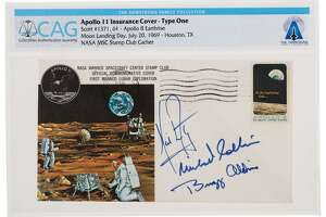 "An envelope ""insurance cover"" signed by Apollo 11 crew members was placed at auction in November at Heritage Auctions. The covers were given to crew members' wives to sell if the astronauts didn't return home. Astronauts didn't qualify for life insurance."