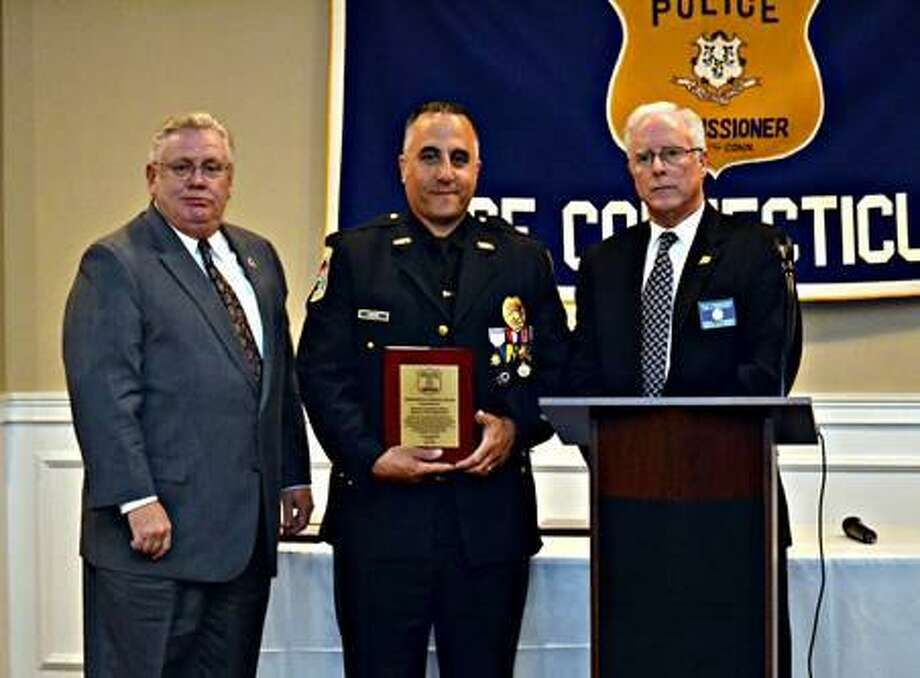 Danbury Police Detective Leonard LaBonia, center, with Danbury Police Deputy Chief Shaun McColgan, left, and PCAC Second Vice President Dan O'Connor at the Meritorious Service Awards Dinner at Vazzy's Four Seasons Restaurant on May 29, 2019. Photo: Police Commissioners Association Of Connecticut Photo