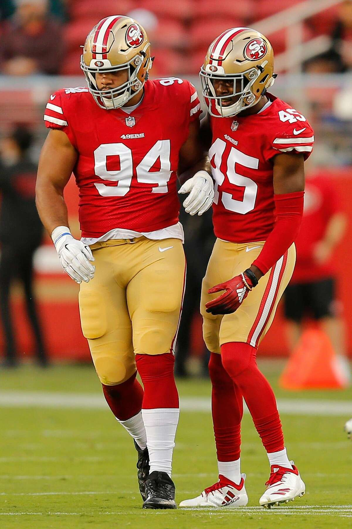 San Francisco 49ers defensive end Solomon Thomas (94) and defensive back Tarvarius Moore (45) during an NFL game against the Los Angeles Chargers at Levi's Stadium on Thursday, Aug. 30, 2018, in Santa Clara, Calif.