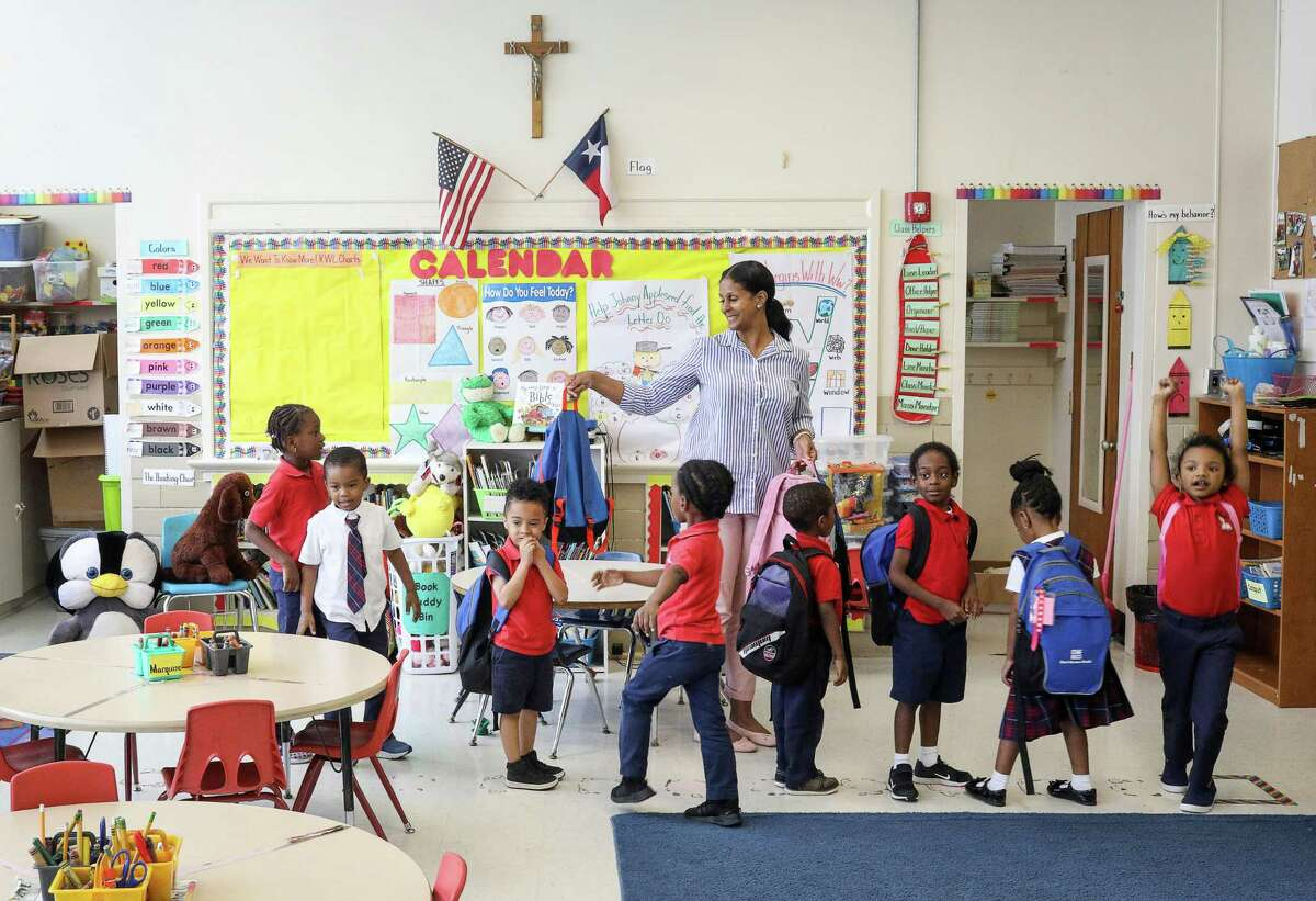 Julie Cook, center, readies her students for dismissal after a prayer at the end of the school day at Saint Peter the Apostle Catholic School on Tuesday, May 14, 2019, in Houston. The school closed last year because of low enrollment. This week, the Archdiocese of Galveston-Houston announced it would close four additional schools in Houston and Pasadena.