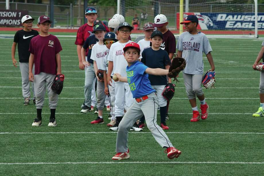 Campers wait their turn as Justin Arredondo participates in a throwing and fielding drill Wednesday at the Pearland High School summer baseball camp. Photo: Kirk Sides / Staff Photographer / © 2019 Kirk Sides / Houston Chronicle