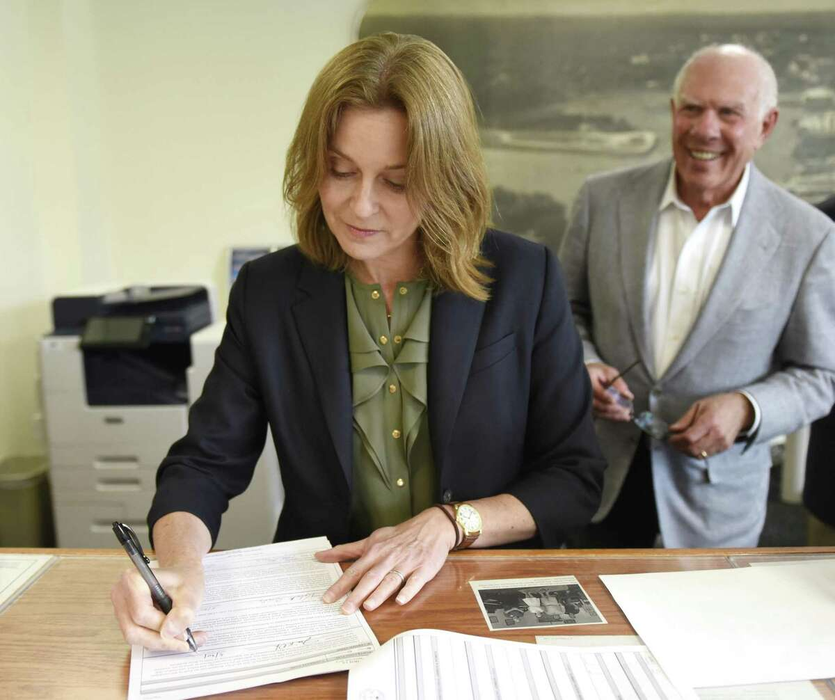 Democratic candidate for First Selectman Jill Oberlander and her running mate Sandy Litvack file their declaration papers at Town Hall in Greenwich, Conn. Thursday, May 30, 2019. Oberlander is currently the Chair of Greenwich's Board of Estimate and Taxation while Litvack is currently the minority Selectman and former Vice Chairman of Walt Disney.