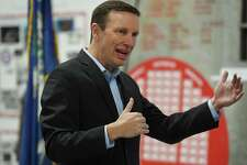 Senator Chris Murphy meets with local veterans at the Veterans Museum & Learning Center in West Haven on May 30. U.S. Murphy address the academic shortcomings of college athletics in his latest report.