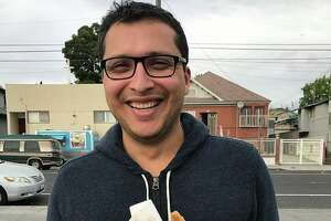 """Photographer Eddie Hernandez calls this candid photo of himself, taken by his girlfriend, is a good example of how he might capture a client in a dating app profile photo.   """"I would make sure to use a caption to provide additional context i.e., I know where to find the best churros in all the Bay Area,"""" Hernandez said."""