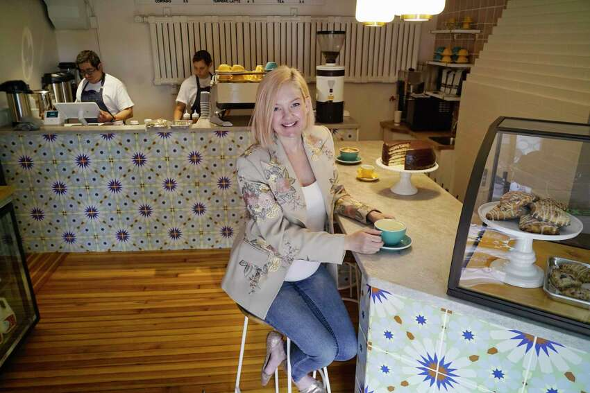 Catherine Hover, owner of Palette Cafe, poses for a photo inside the cafe on Broadway on Thursday, May 30, 2019, in Saratoga Springs, N.Y. (Paul Buckowski/Times Union)