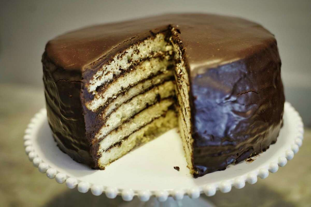 A view of a six-layer doberge cake glazed with chocolate ganache at Palette Cafe on Thursday, May 30, 2019, in Saratoga Springs, N.Y. (Paul Buckowski/Times Union)