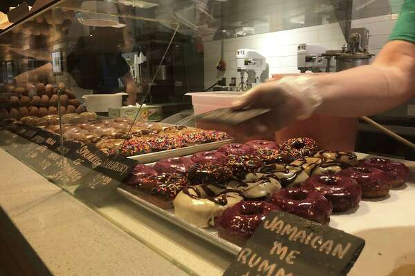 Employees at Cider Belly Doughnuts in Albany come in each morning around 3:30 a.m. to make more than 2,000 donuts for the store.