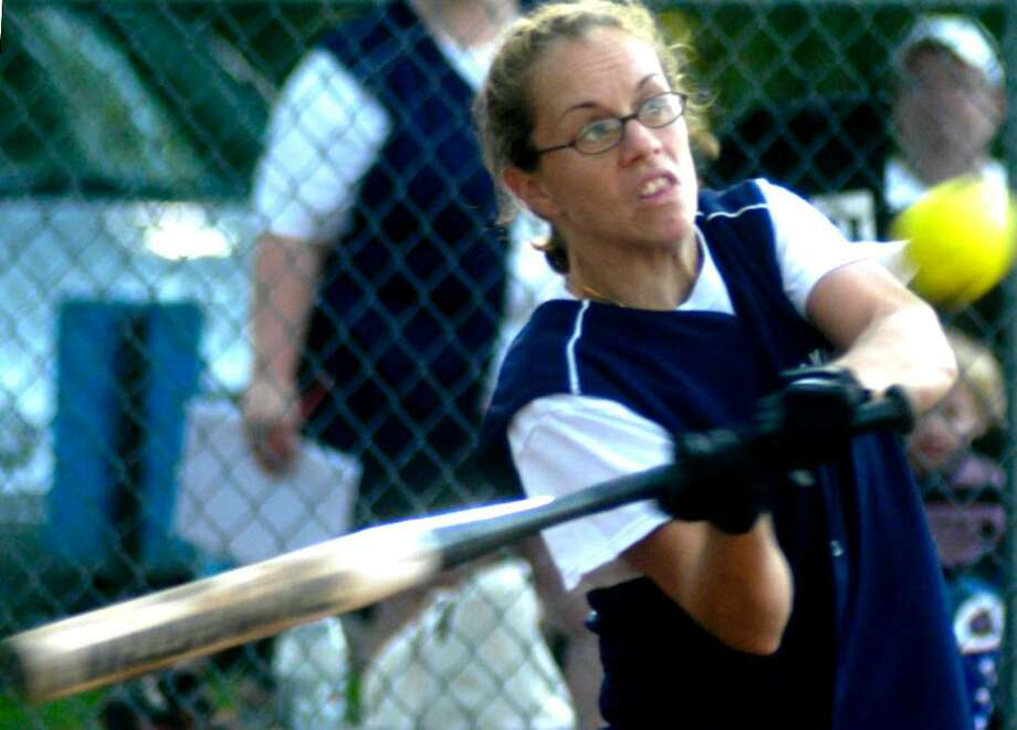 SPECTRUM/Adrienne Williams of the New Milford Police Union women's softball team takes her swings Monday, Juklly 19, 2010 during New Milford Parks & Recreation adult slowpitch softball action at Young's Field. Photo: Norm Cummings / The News-Times