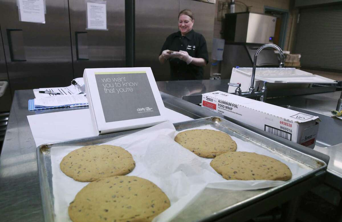 Lisa Guertin, Food Services Department Director for Clarity Child Guidance Center, packages a hand-made cookie to be placed in a box and given to discharged patient on Thursday, May 30, 2019. The nonprofit is the only one of its kind in South Texas and serves as inpatient hospital and outpatient mental health center for children between the ages of 3 and 17. The center is facing a major financial setback as United Way cut its annual funding by 69 percent. The facility first opened in San Antonio in 1886 as an orphanage and now is in the Medical Center offering inpatient and outpatient services regardless of a client's ability to pay. They are struggling financially with the shortfall and after a recent facility expansion, are operating in the red. The center's brand-new administrator isn't giving up and hopes to bring in enough donations to remain open. (Kin Man Hui/San Antonio Express-News)