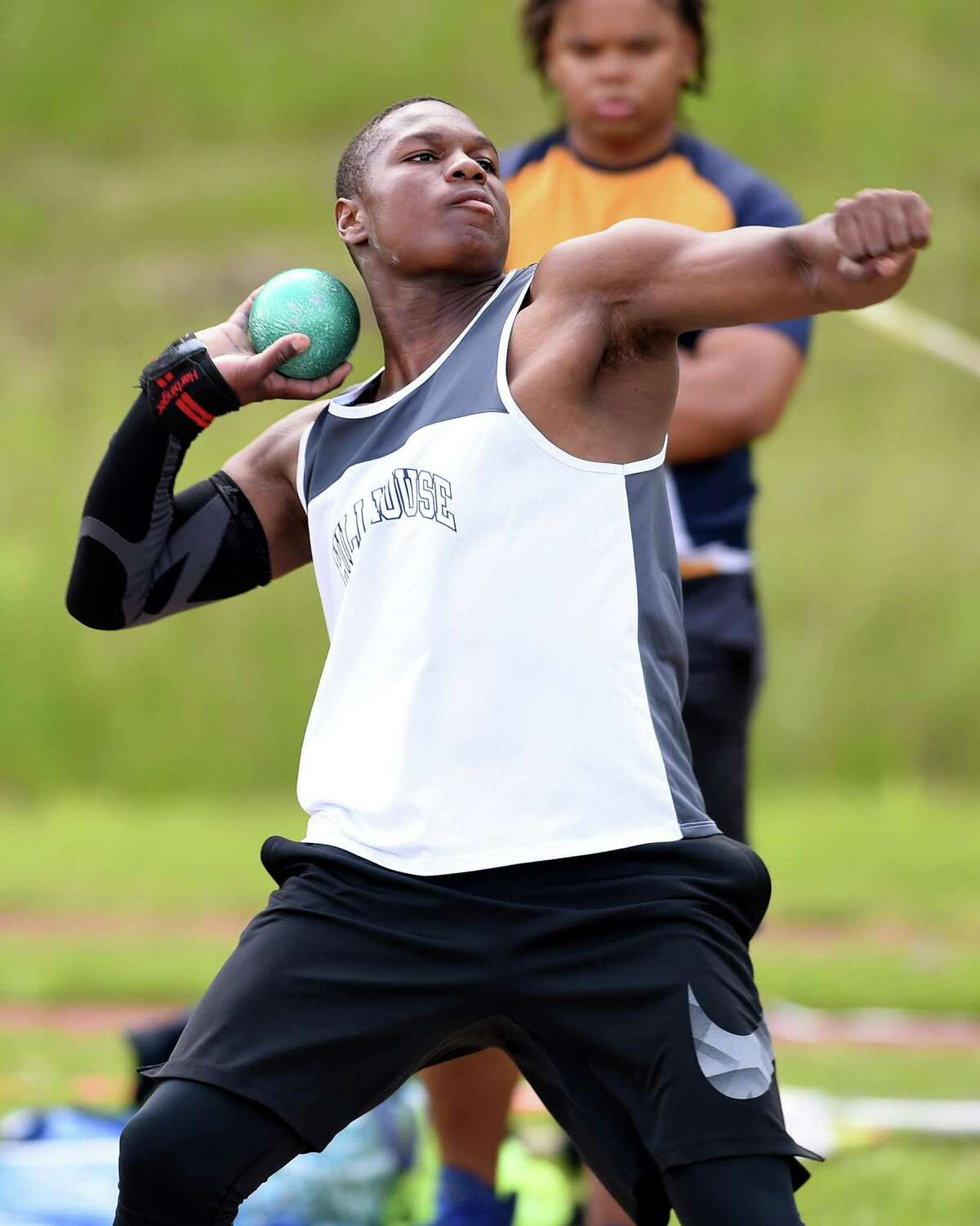 Gary Moore, Jr., of Hillhouse throws the shot put in the CIAC Class MM Outdoor Track & Field Championship at Middletown High School on May 29, 2019.