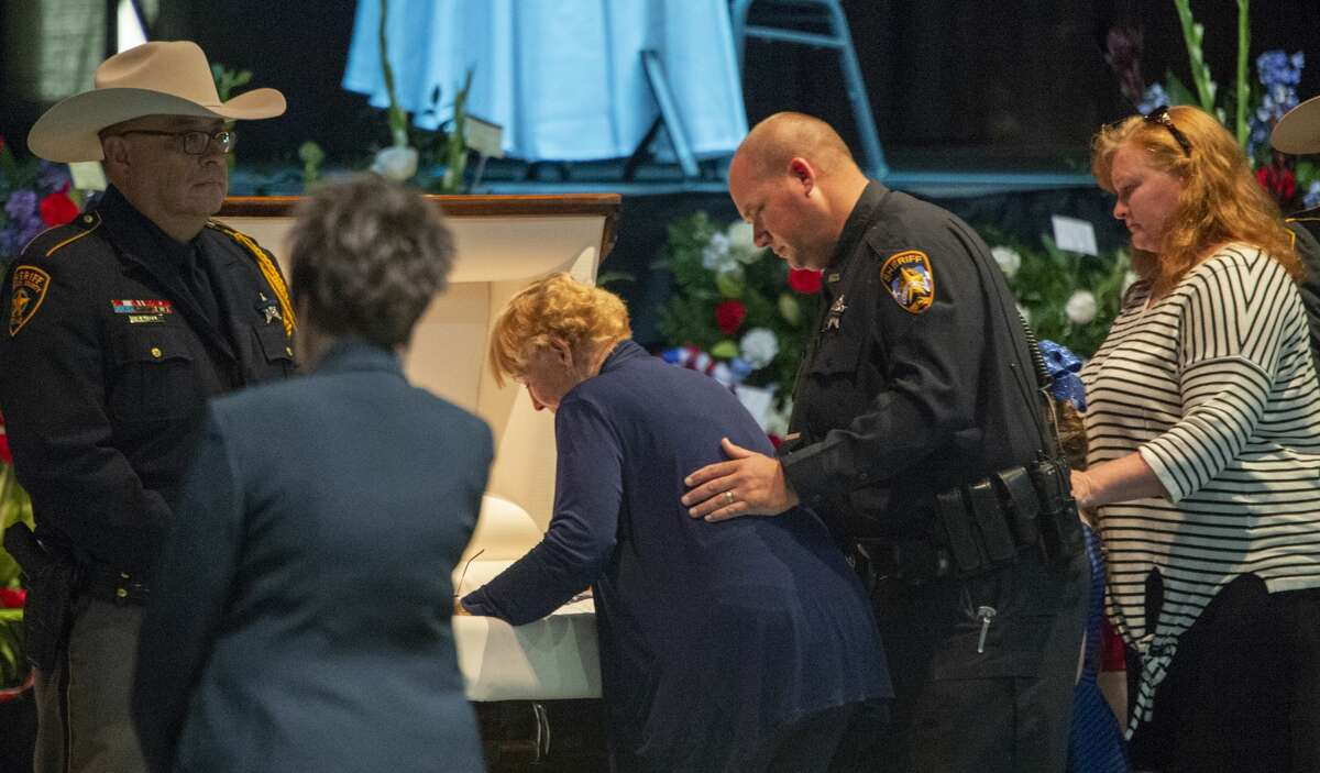 Members of the Gary Painter's family pay their final respects 05/30/19 at the funeral for Sheriff Gary Painter at the Midland Horseshoe. Tim Fischer/Reporter-Telegram