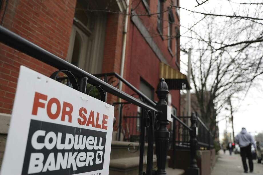 Single-family home sales in Connecticut during April were off by 5 percent compared to the same period a year earlier, according to the Massachusetts-based publisher of The Commercial Record. Photo: Jenny Kane / Associated Press / ap