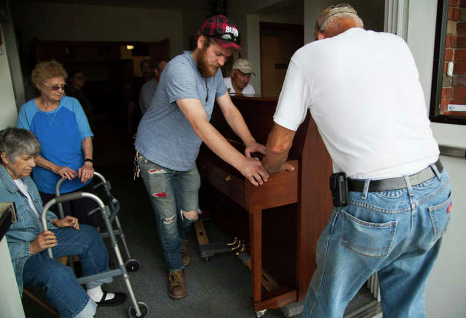 Members of the First Church of God in West Alton were busy moving the church's piano and other items to safety Thursday morning as river levels continued to rise. Photo: By Jeanie Stephens