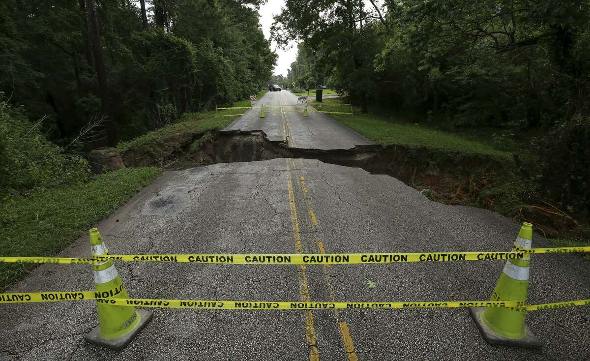 Part of Hamblen Road washed away following overnight storms in the area Wednesday, May 8, 2019, in Kingwood, Texas. (Godofredo A. Vásquez/Houston Chronicle via AP)