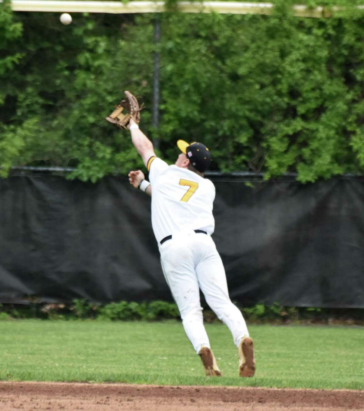 Hand's Phoenix Billings reaches out for a line drive in the Class L second round game at Hand on Thursday.